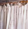 lots of dresses hanging wedding dress trends