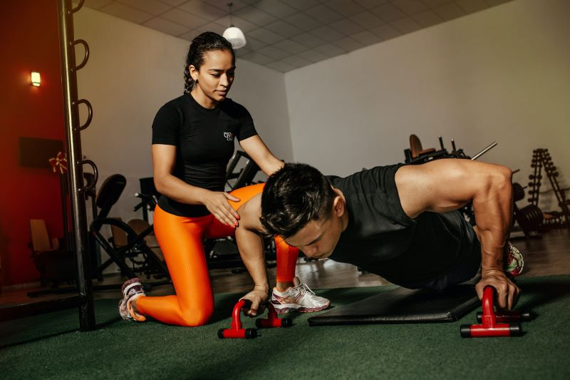 man training health and fitness advice with personal trainer