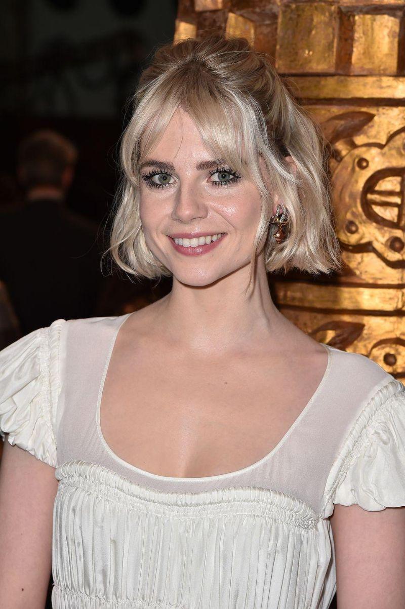 short blonde hair with curtain bangs